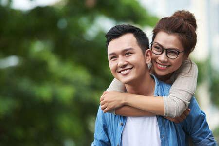 Carefree Asian Couple Enjoying Date Outdoors