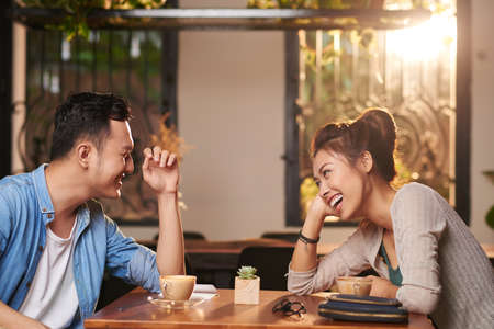 Laughing Couple on Date in Cafe Stock Photo - 80736519