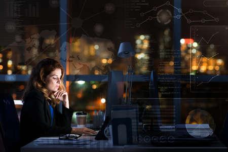 Pretty Businesswoman Working Overtime