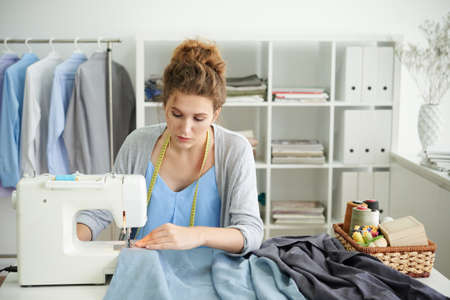 Sewing male shirts 写真素材