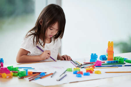 Cute Little Girl Focused on Drawing