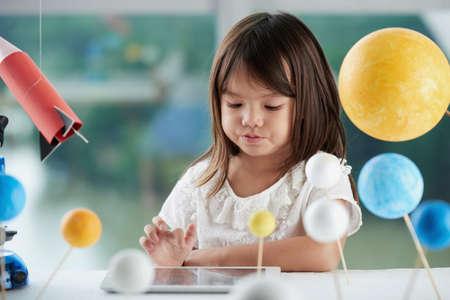 viewing: Little Girl Using Digital Tablet