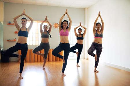 Portrait of Cheerful Yoga Practitioners Stock Photo