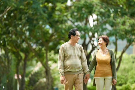 Cheerful couple in park