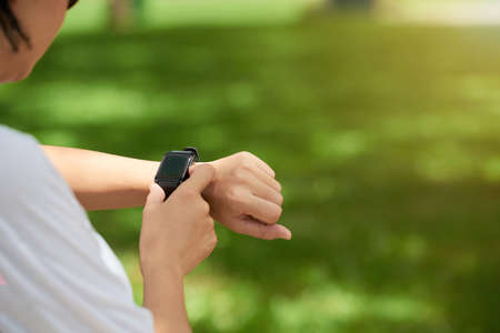 Fitness Watch on Womans Wrist Stock Photo