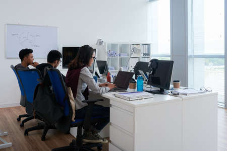 Young software developers working on new project in office Imagens