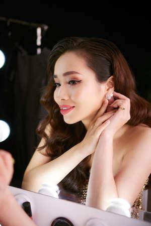 Putting on beautiful earring