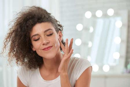 Young lady enjoying smooth skin