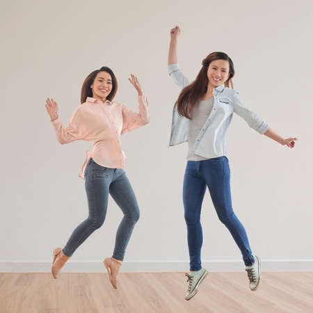 Cheerful girls jumping around