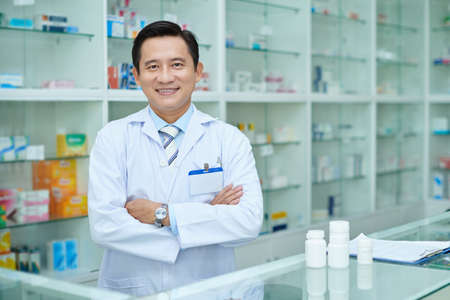 Portrait of of confident Vietnamese drugstore worker Stockfoto