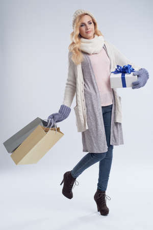 Pretty woman with gifts Stock Photo