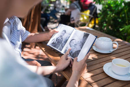 Looking at black and white photos Stock Photo