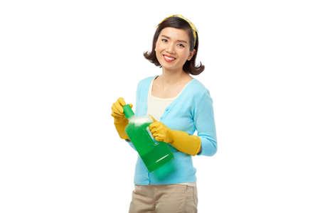 Pretty Housewife with Detergent Bottle Stock Photo