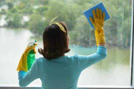 Housekeeper Cleaning Panoramic Window