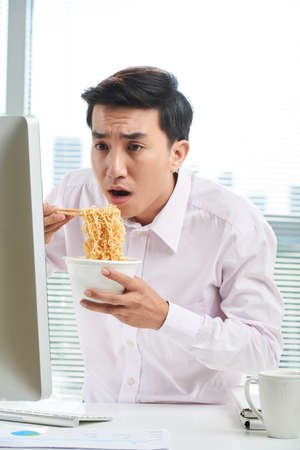 Asian Office Worker at Lunchtime