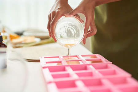 Pouring soap into forms