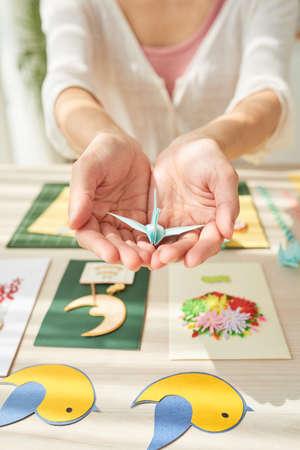 Female Hands Holding Origami Crane Banco de Imagens