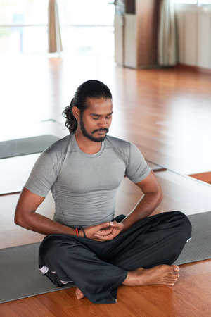 Indian yogi concentrated on his breath during yoga practice
