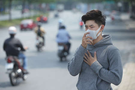 Red alert in polluted big Asian city Stock Photo