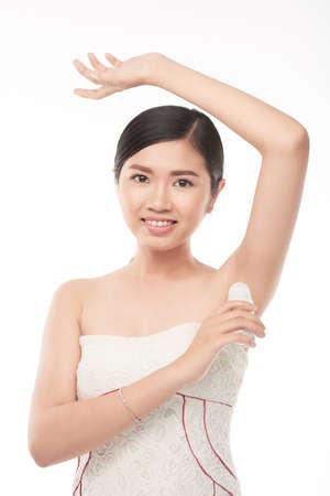 Applying deodorant Stock Photo
