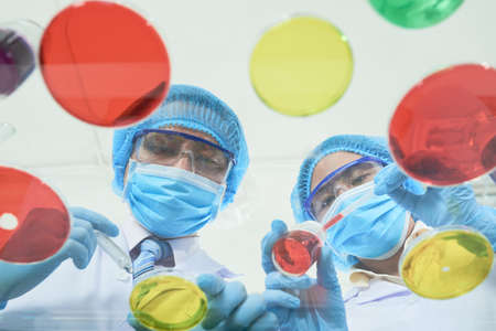 Asian Scientists Focused on Work Stock Photo