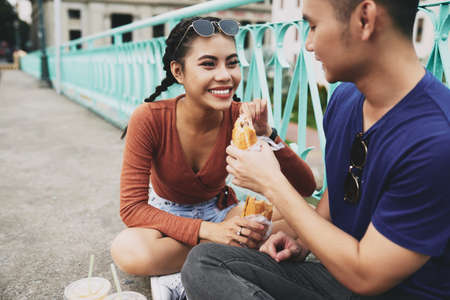 Couple enjoying sandwiches Reklamní fotografie - 101103276