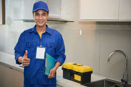 Repairman in kitchen