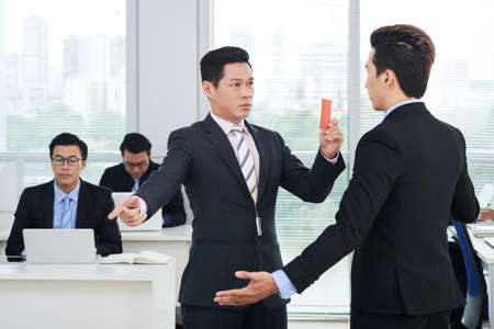 Showing Red Card to Subordinate Stock Photo