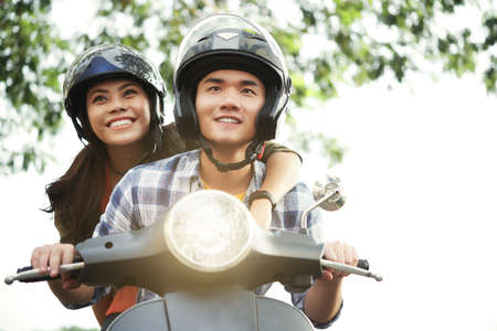 Couple riding motorbike