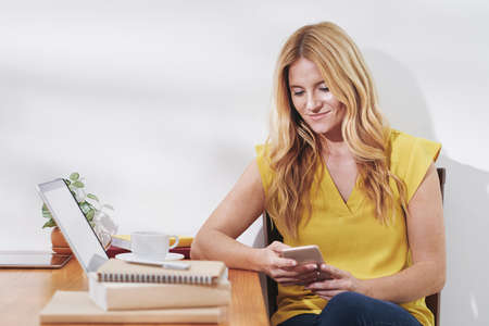 Woman spending time with smartphone Stock Photo