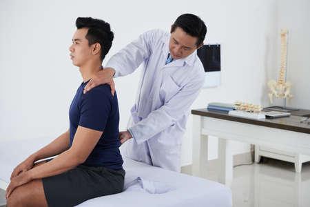 Checking spine Standard-Bild