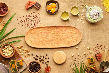 Empty wooden tray prepared for moon cakes for traditional Asian mid autumn festival Stock Photo