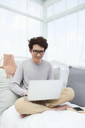 Guy playing on laptop