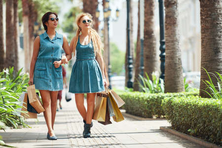 Shopping women  walking together