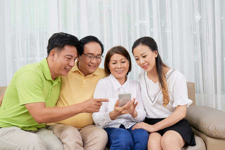 Big family with smartphone
