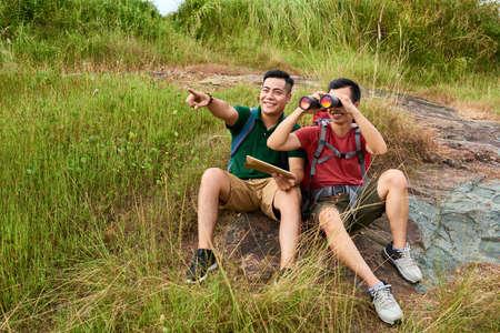 Travelers with binoculars Stock fotó