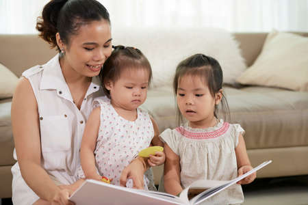 Mother reading for children Stock Photo