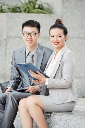 Cheerful Asian entrepreneurs
