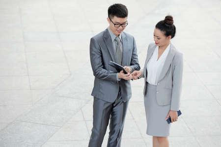 Entrepreneurs checking data on tablet