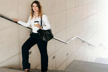 Businesswoman standing on stairs