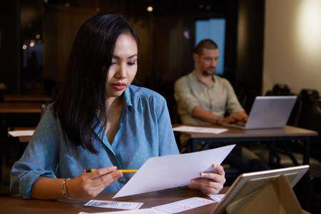 Businesswoman analyzing document
