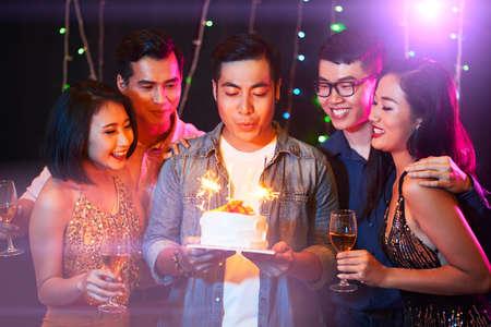 Birthday man blowing candles Standard-Bild