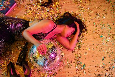 Drunk woman on the floor Stock Photo