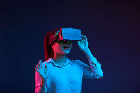 Young business lady in VR glasses Stock Photo