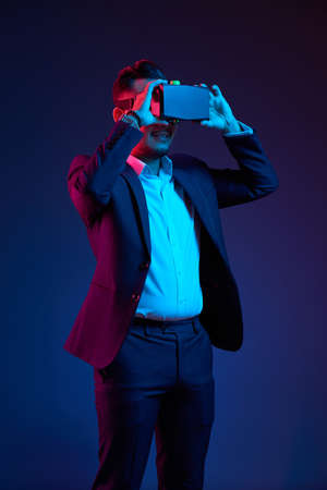 Business executive with virtual reality glasses