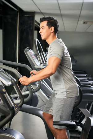 Handsome Vietnamese man in gym
