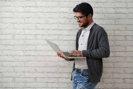 Cheerful programmer with laptop Standard-Bild