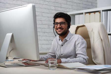 Positive Indian business executive
