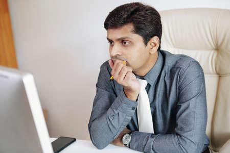 Pensive Indian entrepreneur