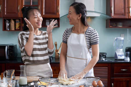 Mother and daughter enjoying cooking